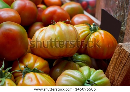 Mixed heirloom tomatoes in wooden box
