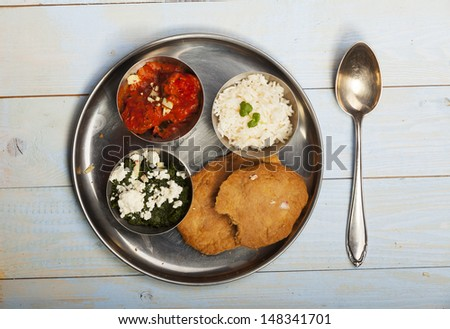 mixed indian thali food with rice  - stock photo