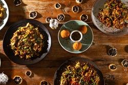 Mixed kottu dishes at a sri lankan restaurant
