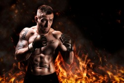 Mixed martial artist posing against the backdrop of fire and smoke. Concept of mma, ufc, thai boxing, classic boxing. Mixed media