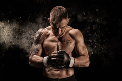 Mixed martial artist posing on a black background. Concept of mma, ufc, thai boxing, classic boxing. Mixed media