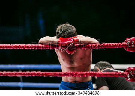 mixed martial arts fighter (MMA) stands in corner ring. lost fight. defeat of an opponent Stock photo ©
