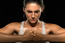 Mixed martial arts fighter woman gym athlete close up focused meditating conceptual