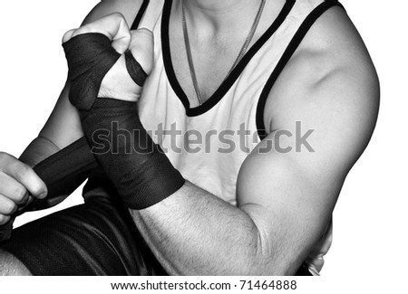 mixed martial arts fighter wrapping wrists - stock photo