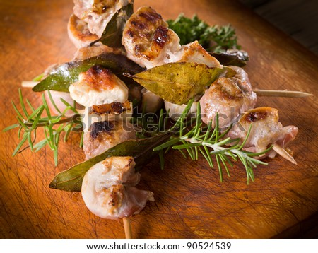 mixed meat skewer on wooden background