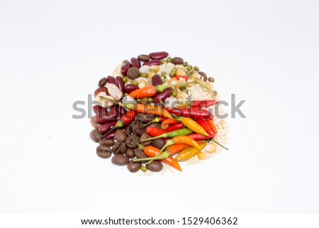 Mixed natural chili, corns, roasted peanuts, roasted coffee beans, kidney beans and green beans on white background and agriculture product concept