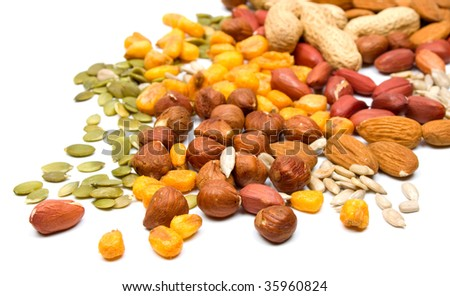 Mixed nuts and seeds isolated on white background