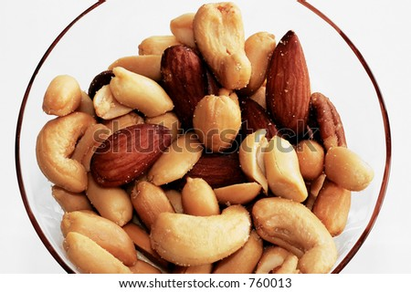 Mixed nuts in glass.