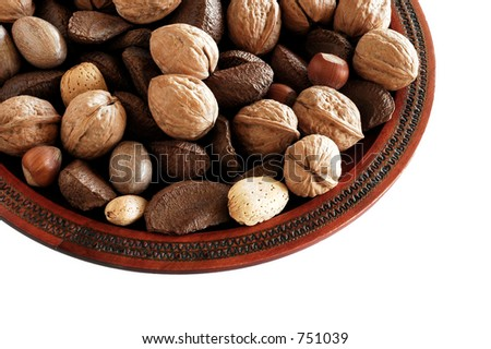 Mixed nuts in wooden plate.