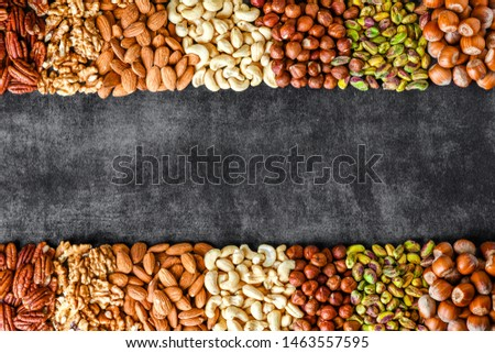 Mixed nuts like walnut, pistachio, almond, pecan, cashew, hazelnut. Copy space for text. Various nut banner.
