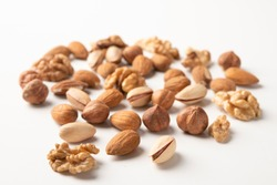 Mixed nuts on a white surface