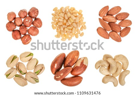 mixed of nuts heap isolated on white background. Almonds, cashews, hazelnuts, pine and brazil nuts. Top view. Flat lay #1109631476