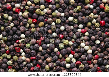 Mixed peppercorns background. Different colored peppercorns, close up.  Stock photo ©