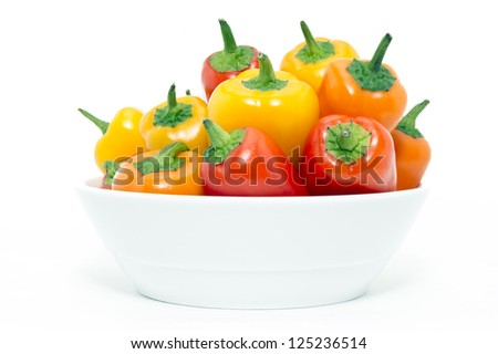 Mixed Peppers in white plate on white background