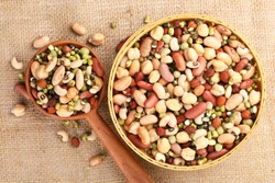 Mixed pulses, beans and peas soaked in water as a preparation step for cooking, Nutritional food.