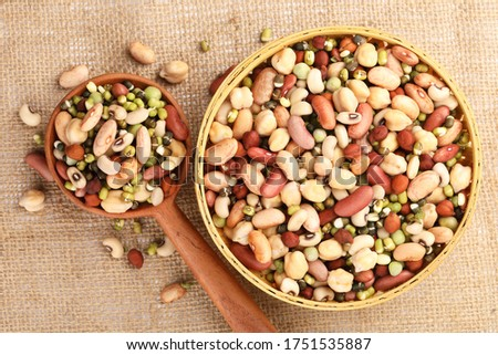 Photo of  Mixed pulses, beans and peas soaked in water as a preparation step for cooking, Nutritional food.