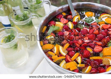 mixed punch with fresh fruits in metal bowl - stock photo