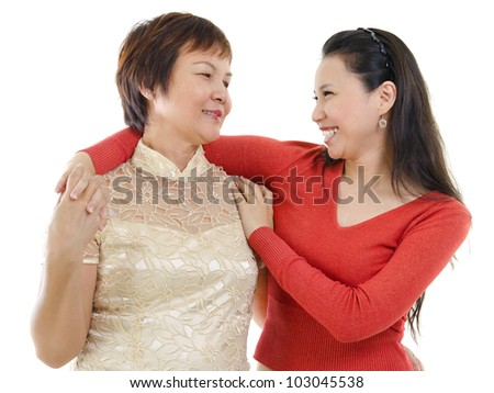 Mixed race Asian mother and daughter having conversation on white background