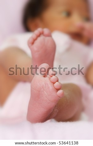Mixed race baby girl, focus on feet