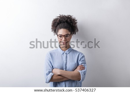 Mixed race businesswoman, wearing glasses