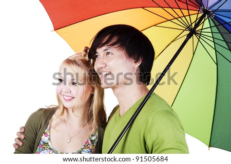 Mixed race couple holding an umbrella isolated on white