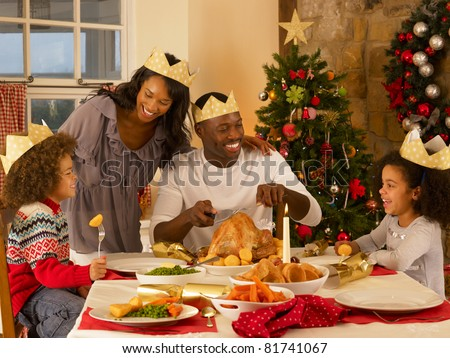 Mixed race family having Christmas dinner #81741067