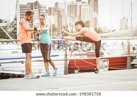 Mixed race group of young athletic runners enjoying a morning of exercise