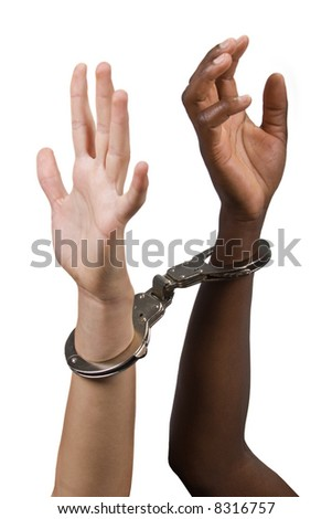 Mixed race hands Caucasian African American, man and woman, with handcuffs