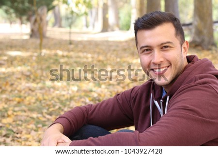 Mixed race male smiling in the fall with copy space