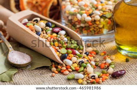 Mixed raw legumes, pulses in a wooden scoop, closeup view with details Stock photo ©
