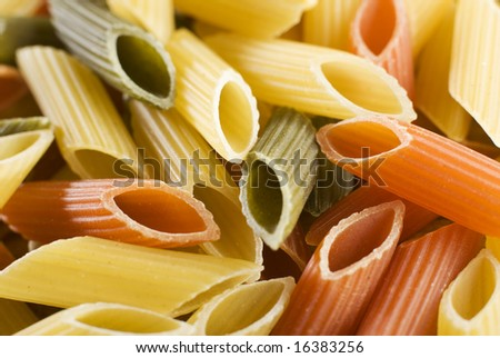 mixed raw pasta background close up shoot