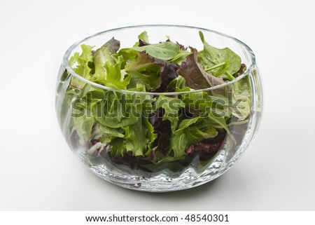 Mixed salad leaves in a glass bowl