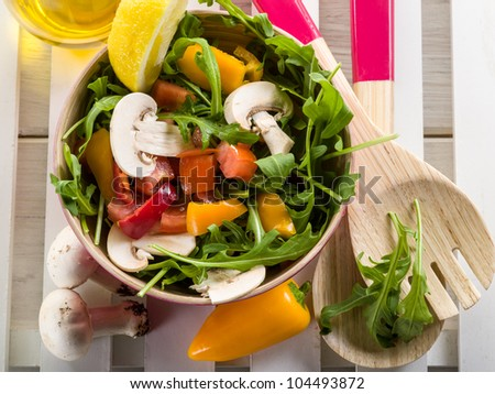 mixed salad with arugula mushroom and capsicum