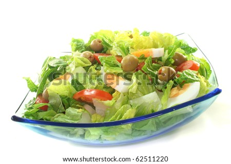 Mixed salad with egg, tomatoes, olives and salad leaves