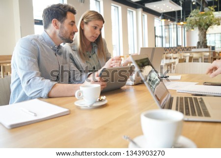 Mixed sales team working through presentation before meeting