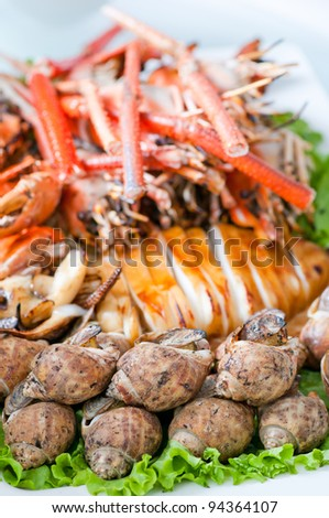 mixed seafood, grilled prawns, roast squid and grilled sea snail