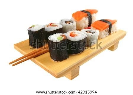 mixed sushi plate with sticks on white background