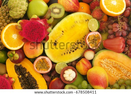 Mixed tropical fruits, fresh fruits background