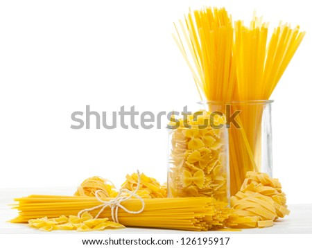 Mixed uncooked raw italian pasta with spaghetti, farfalle and tagliatelle - stock photo