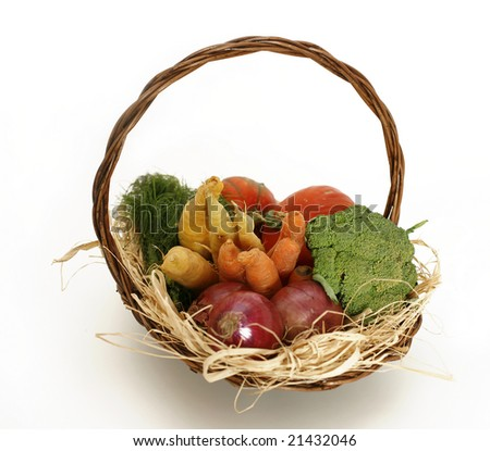 Mixed vegetable basket display on black background