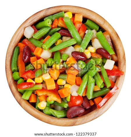 mixed vegetables in wooden bowl isolated, top view - stock photo