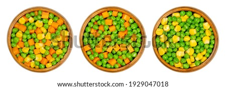 Mixed vegetables in wooden bowls. Three mixes of green peas, corn and carrot cubes. Mix of peas, carrots cut in cubes and vegetable maize, also called sugar or pole corn. Close up, macro, food photo.
