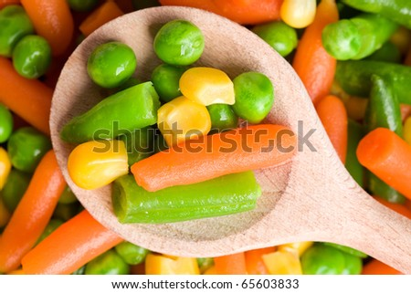 mixed vegetables on wooden spoon