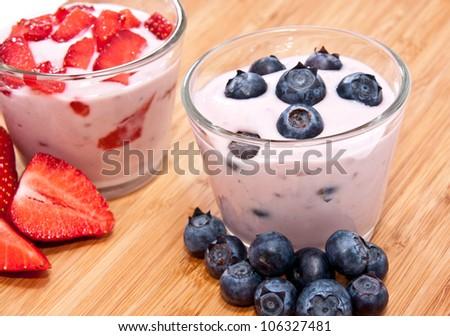 Mixed Yogurts (Strawberry and Blueberry) on wooden background - stock photo