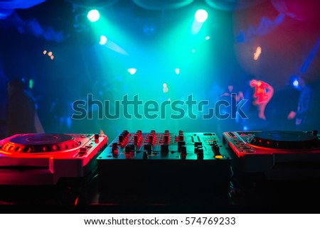 mixer and a DJ booth in the nightclub at a party with a diffuse bright background