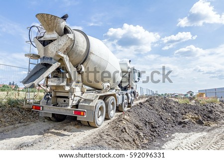 Mixer truck is transporting cement to the casting place on building site.