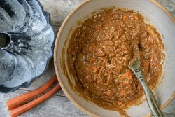 Mixing bowl of carrot cake batter flat lay