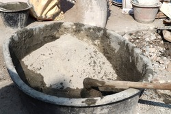 Mixing cement,sand,stone and water in tab for background.