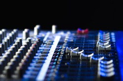 mixing console on a black background, musical instrument for scoring and mixing