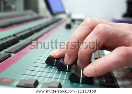 mixing desk and human hand diminishing perspective